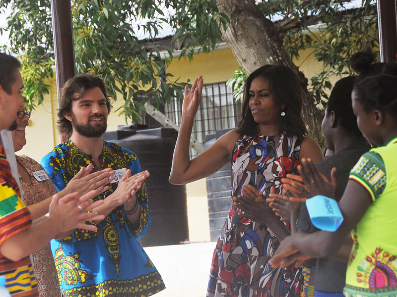 U.S. first lady Michelle Obama, centre, interact with Peace Corps members at a project 70 kilometers (43 miles) from the capital city Monrovia in Kakata, Liberia, Monday, June 27, 2016. Michelle Obama is visiting a leadership camp for girls in Liberia, Monday, the first stop in her latest Africa visit, in a country still recovering from the recent Ebola epidemic that left thousands dead. (AP Photo/Abbas Dulleh)